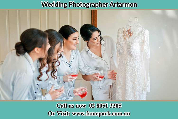 Photo of the Bride and the bridesmaids looking at the wedding gown Artarmon NSW 2064