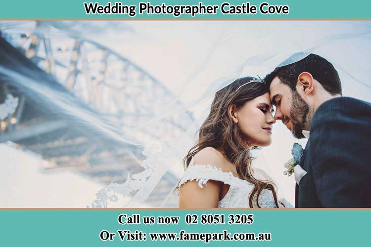 Close up photo of the Bride and the Groom under the bridge Castle Cove NSW 2069
