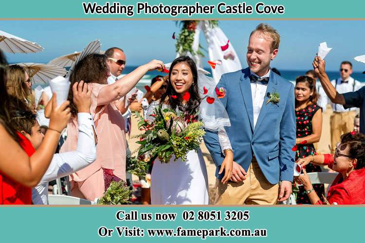 Photo of the Bride and the Groom showering flower petal by the visitors Castle Cove NSW 2069