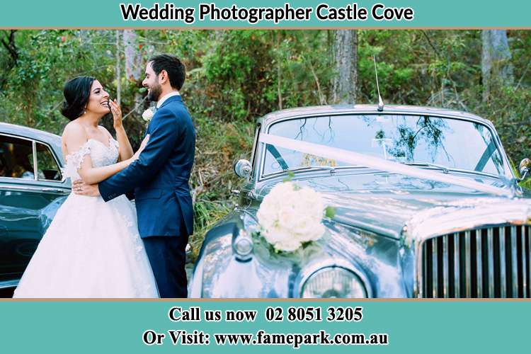 Photo of the Bride and the Groom near the bridal car Castle Cove NSW 2069