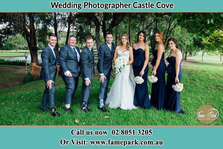 The Bride and the Groom with their entourage pose for the camera Castle Cove NSW 2069