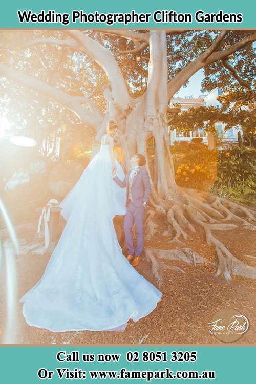 Photo of the Bride and the Groom looking each other besides the tree Clifton Gardens NSW 2088