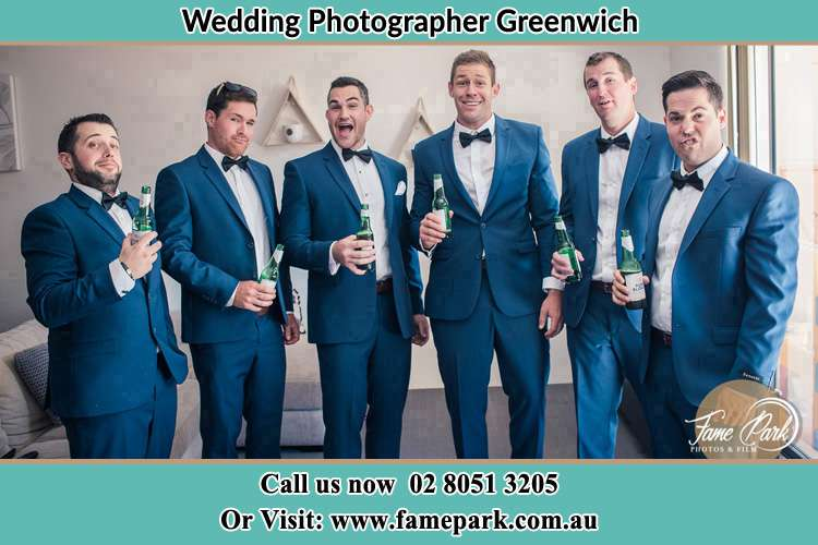 The groom and his groomsmen striking a wacky pose in front of the camera Greenwich NSW 2065