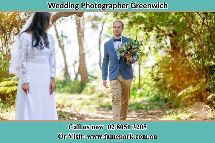 Photo of the Groom bringing flower to the Bride Greenwich NSW 2065