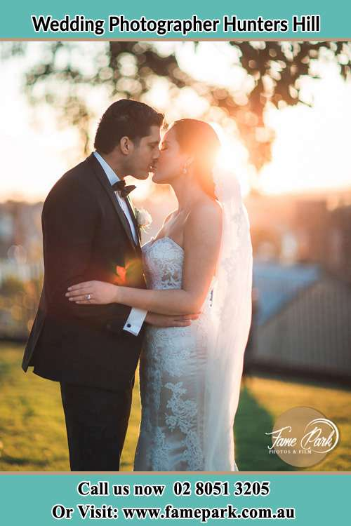 Photo of the Groom and the Bride kissing at the yard Hunters Hill NSW 2110