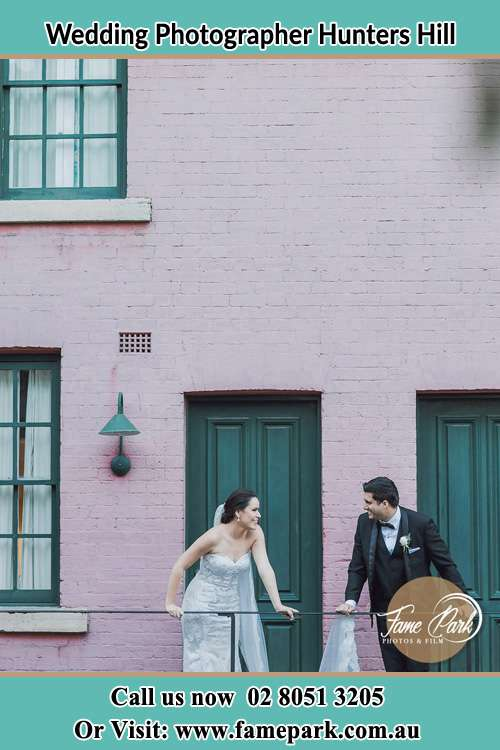 Photo of the Bride and the Groom looking each other at the balcony Hunters Hill NSW 2110