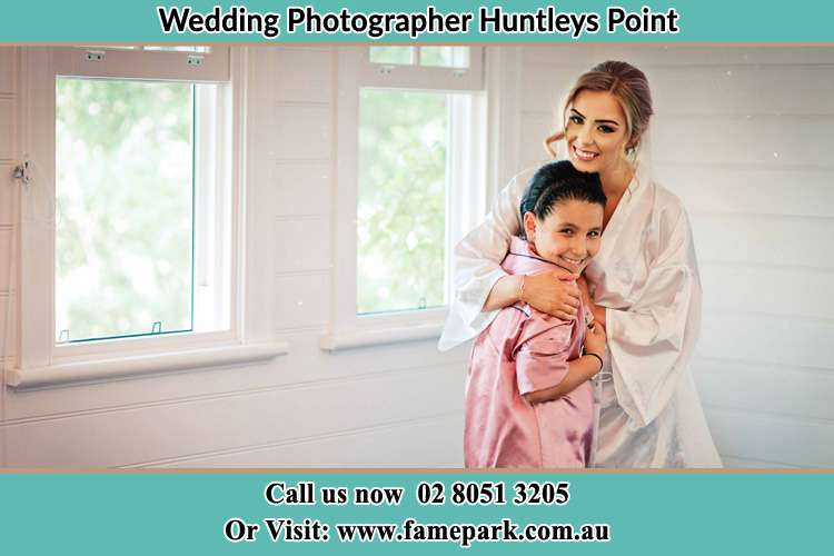 Photo of the Bride hugging the flower girl Huntleys Point NSW 2111
