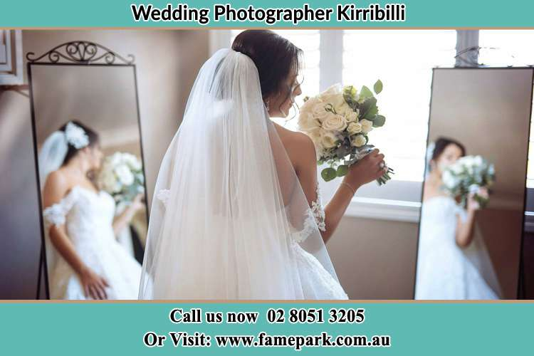 Photo of the Bride holding flower at the front of the mirrors Kirribilli NSW 2061