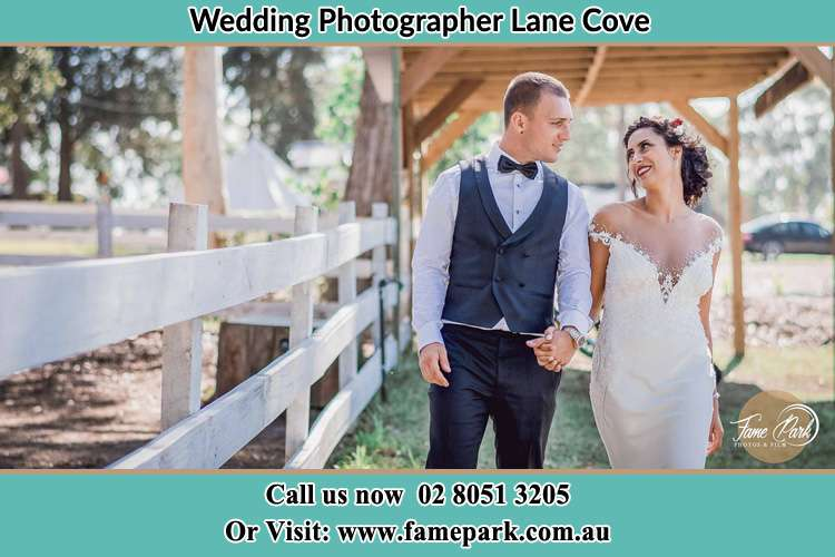 Photo of the Groom and the Bride holding hands while walking Lane Cove NSW 2066