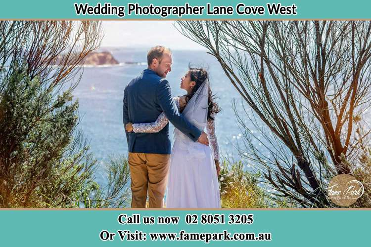 Photo of the Groom and the Bride looking each other near the sea front Lane Cove West NSW 2066