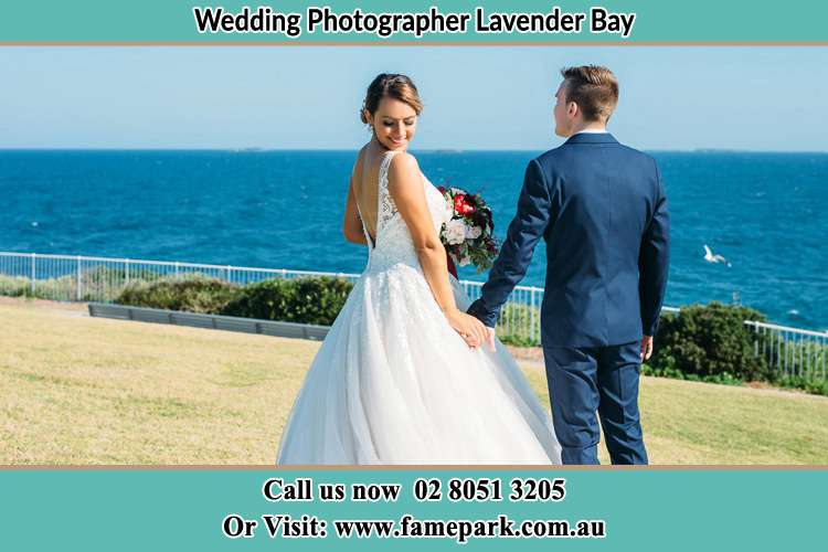 Photo of the Bride and the Groom holding hands at the yard Lavender Bay NSW 2060
