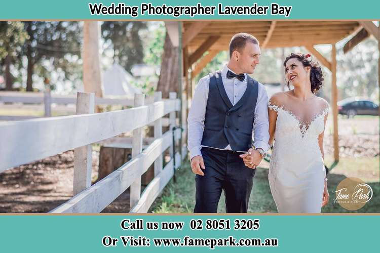 Photo of the Groom and the Bride holding hands while walking Lavender Bay NSW 2060