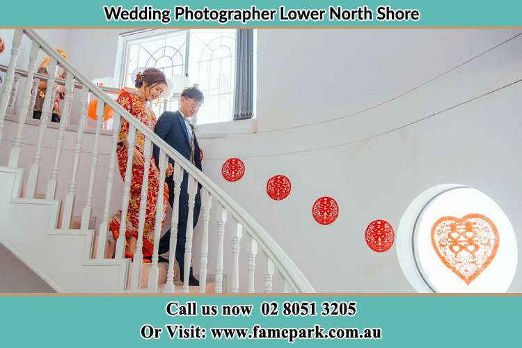 The Bride and the Groom walking down the stairs Lower North Shore