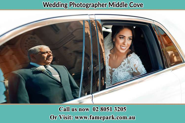 Photo of the Bride inside the bridal car with her father standing outside Milsons Point NSW 2061
