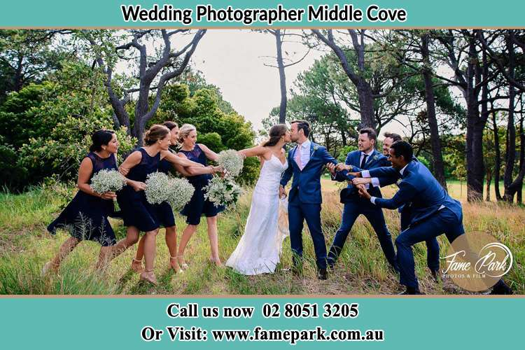 Photo of the Groom and the Bride celebrating with the secondary sponsors Milsons Point NSW 2061