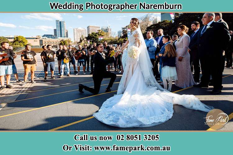 Groom Kneeling down in front of the Bride Naremburn NSW 2065