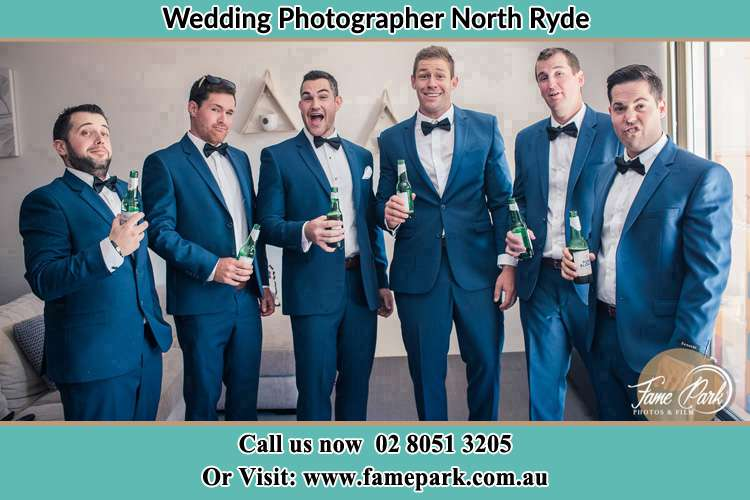 The groom and his groomsmen striking a wacky pose in front of the camera North Ryde NSW 2113