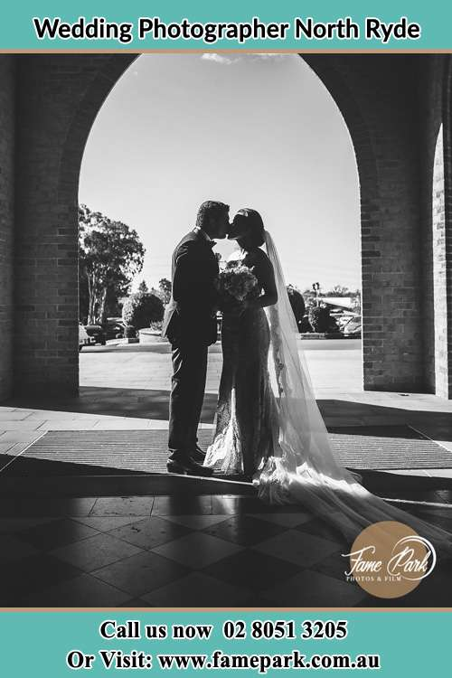 Photo of the Groom and the Bride kissing at the front of the church North Ryde NSW 2113