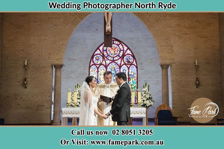 Photo of the Bride and Groom at the Altar with the Priest North Ryde NSW 2113