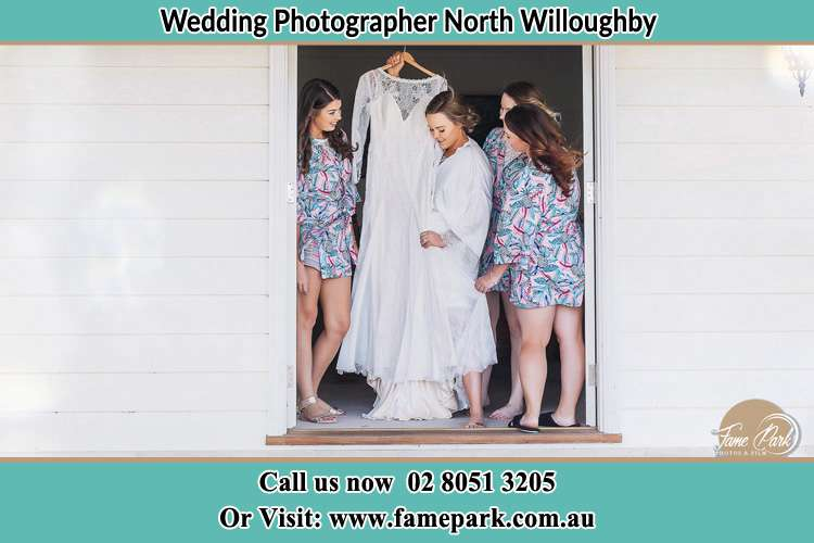 Photo of the Bride and the bridesmaids checking the wedding gown at the door North Willoughby NSW 2068