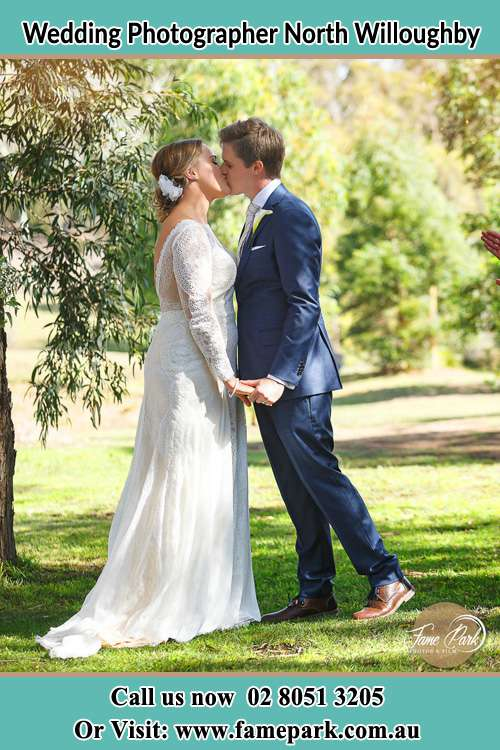 Photo of the Bride and the Groom kissing at the yard North Willoughby NSW 2068