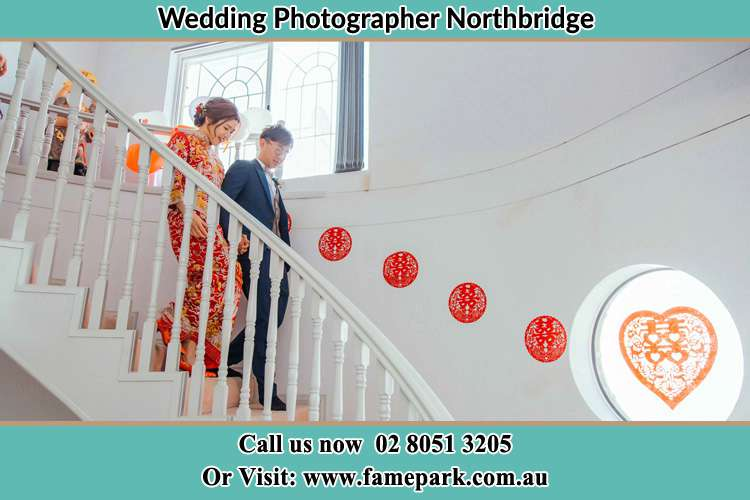 Photo of the Bride and the Groom going down the stair Northbridge NSW 2063