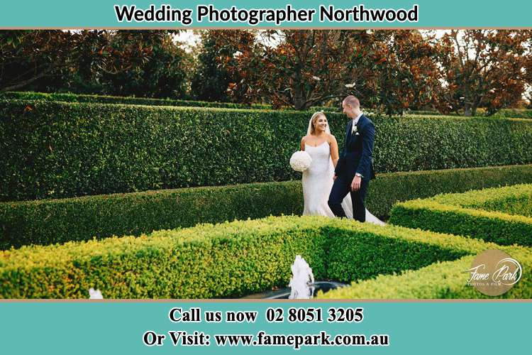 Photo of the Bride and the Groom walking at the garden Northwood NSW 2066