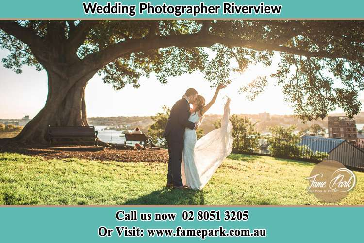 Photo of the Bride and the Groom kissing under the tree Riverview NSW 2066