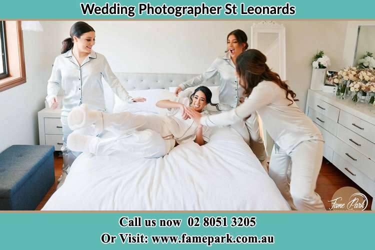 Photo of the Bride and the bridesmaids playing on bed St Leonards NSW 2065