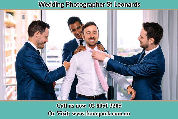 Photo of the Groom helping by the groomsmen getting ready St Leonards NSW 2065