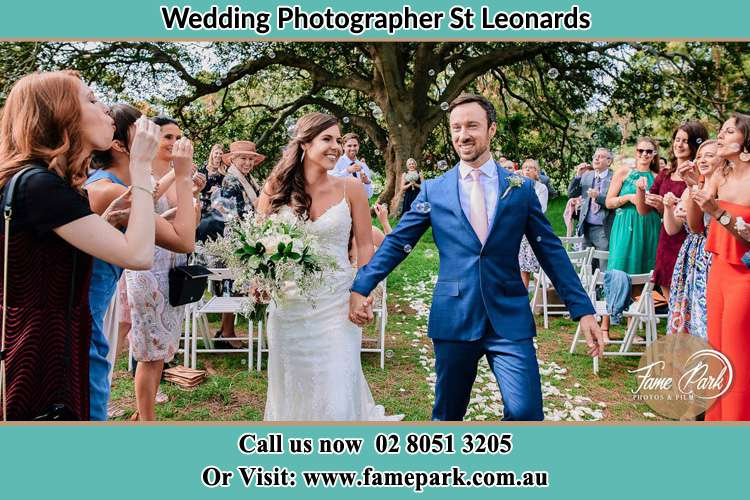 Photo of the Bride and the Groom showering bubbles by the visitors St Leonards NSW 2065