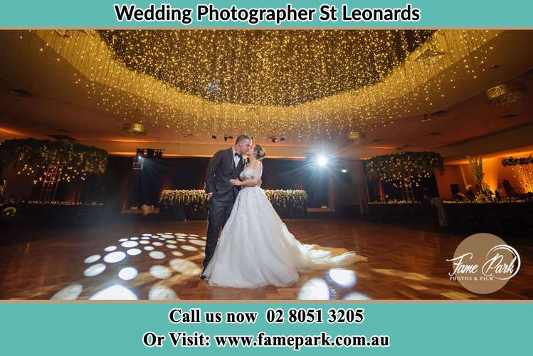 Photo of the Groom and the Bride kissing at the dance floor St Leonards NSW 2065