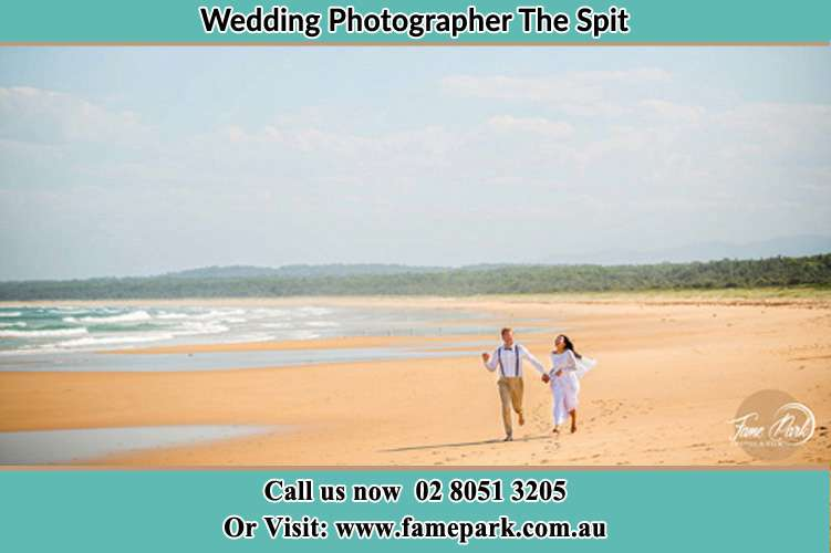 Photo of the Groom and the Bride walking at the sea shore The Spit NSW 2088