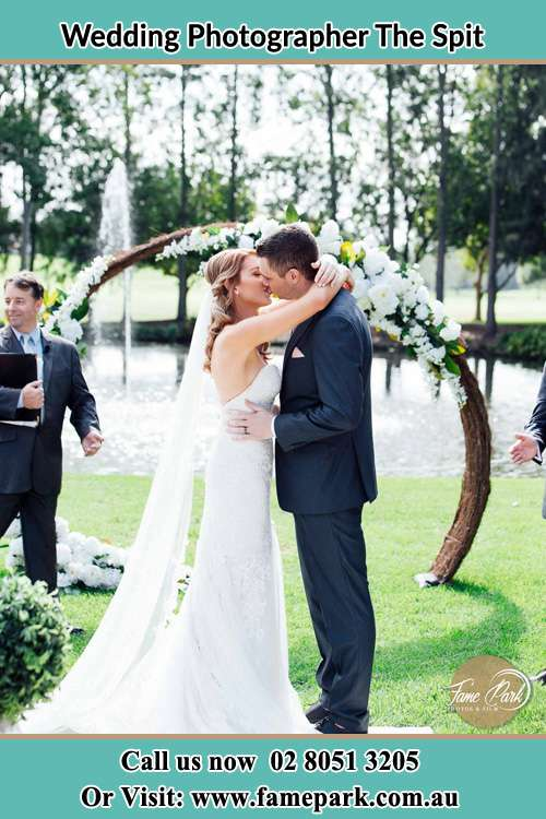 Photo of the Bride and the Groom kissing The Spit NSW 2088