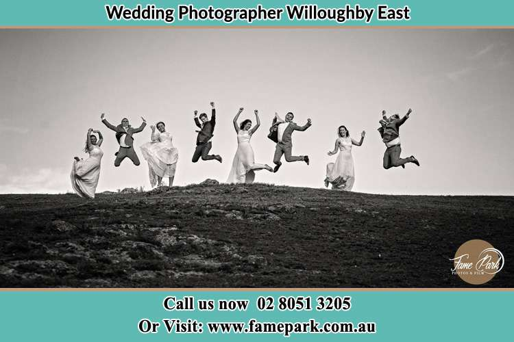 Jump shot photo of the Groom and the Bride with the entourage Willoughby East NSW 2068