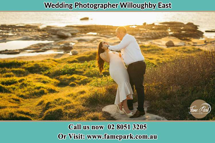 Photo of the Bride and the Groom dancing near the lake Willoughby East NSW 2068