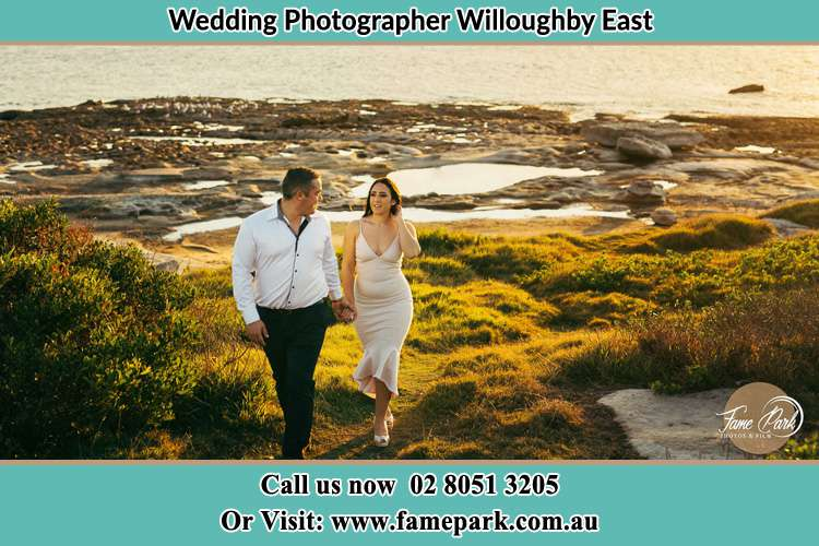Photo of the Groom and the Bride walking near the lake Willoughby East NSW 2068