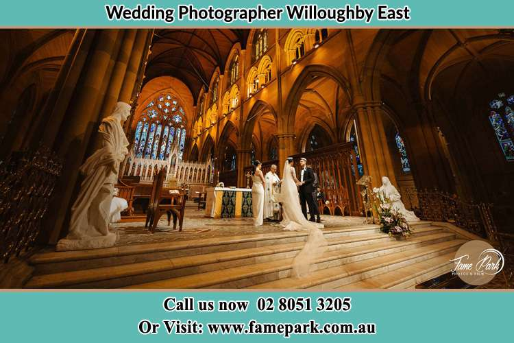 Photo of the Bride and the Groom at the altar Willoughby East NSW 2068