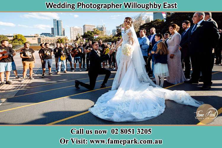 Groom Kneeling down in front of the Bride Willoughby East NSW 2068